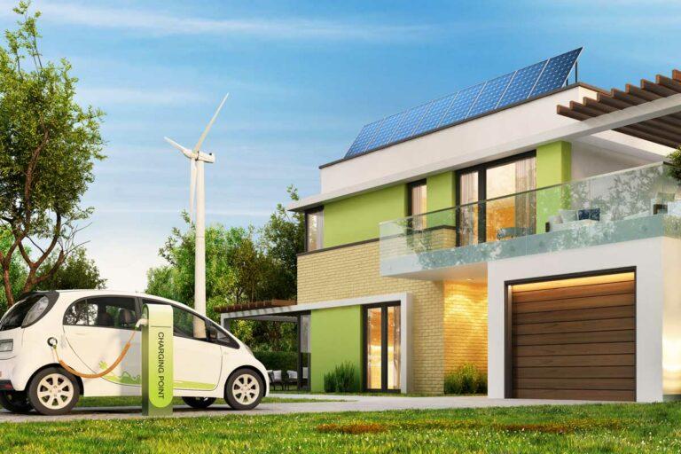 Maison écologique moderne avec panneaux solaires et éoliennes et voiture électrique